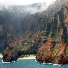 Spectacular rock formations and warm, gem-blue waters make the perfect backdrop for a dream escape in Hawaii | See more: http://www.weddingwire.com/honeymoons/hawaii/l/hawaiis-hidden-hideaways/48cf7b3b025f6477-ebedfef8887c17a4/9110b357720d5c75 // #hawaii #honeymoon