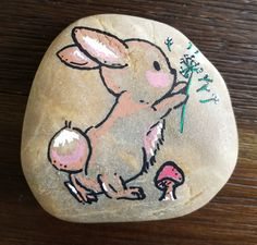 Bunny rock painting by Rebeca Page