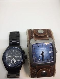 LOT INCLUDES A MENS FOSSIL LEATHER BAND WATCH WITH BLUE FACE (MODEL JR-8965) AND A MENS FOSSIL CHRONOGRAPH WATCH WITH BLACK BAND (CH-2692) - THERE IS A CRACK IN THE CRYSTAL.