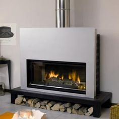 Collection de range buches chimney de serax fireplace for Poele a bois contemporain