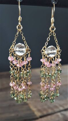 This is an absolutely stunning pair of handmade chandelier earrings! I selected genuine pink Morganite and green Apatite to add color to the design, wire wrapping each gemstone with 14 karat gold filled wire. At the center of each earring is a beautiful pale pink Amethyst which is faceted cut and sparkly. There earrings are light and elegant, and would be great worn with your spring and summer outfits! - Materials: 14 karat gold filled wire and ear hooks, genuine pink Morganite, genuine…