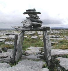 At Poulawack Cairn, a cairn dating from 3400 BC. The Burren, Ireland. We visited the Burren last year and the energy in this place was very special. Stone Cairns, Emerald Isle, Land Art, Ireland Travel, British Isles, Stone Art, Ancient History, Archaeology, Statues