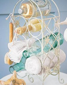 """Wine Rack to store towels and small items...Click on the image for more information on """"DIY Bathroom Storage"""" by Kitchen Bath Trends"""