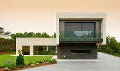 Bauhausstil: Minimalism And Stone Facade by Foraster Arquitectos
