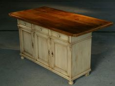 old table top attached to sideboard = kitchen island. overhang at one end for sitting @, drawers a plus. this would be great.
