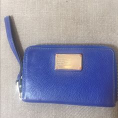 Marc Jacobs Wristlet Wallet Beautiful sapphire blue Wristlet wallet...great condition...zips all the way around Marc by Marc Jacobs Bags Clutches & Wristlets