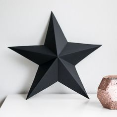 Simple Christmas decor - a 3D paper star made out of black card stock.