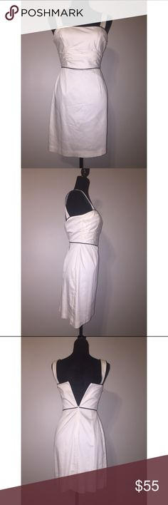 WHBM Sheath White Dress Black Trim Beautiful white dress with black trim - great condition (especially for a white dress! No stains or discoloring) - worn once - shell 96% cotton, 4% spandex; lining 100% acetate - size 0 (reason it isn't zipped all the way in the back... mannequin is too large) White House Black Market Dresses