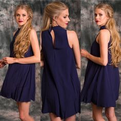 GIRLS NIGHT OUT HPSerena Mock Navy Dress Navy dress with beautiful embroidery on the front and neckline. Fully lined!  100% Rayon. I have extra small, small medium and large Please contact me to make your own listing! Absolutely No Trades! My first host pick! And many more to come! Lewboutiquetwo Dresses