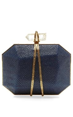 Shop Iris Clutch In Ocean Stingray. This faceted stingray box clutch from Marchesa features tiny crystal inlay in a gold-tone setting Prism quartz push lock closure with wrap-around crystal inlay Stingray body with gold-tone metal frame Tulle lined Womens Purses, Clutch Purse, Blue Clutch, Gold Clutch, Leather Clutch, Beautiful Bags, My Bags, Evening Bags, Fashion Bags