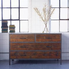 Baxter Square Industrial Four Drawer Chest. Our versatile Baxter chest of drawers, made from reclaimed pine and antiqued metal, combines an industrial feel with a simple design which can lend itself to any room in your home.