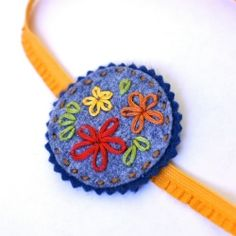 Make yourself or your little lady a sweet stitched wool felt accessory with the instructions in this simple tutorial.