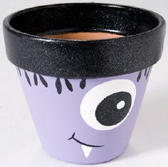 Plaid® One-Eyed Purple Monster Pot... a small clay pop would be the perfect flatware holder for a monster party or kids Halloween party.