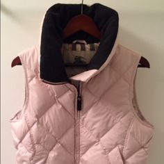 Burberry puffy pink vest 100% auth. Super cute and rare! Fantastic condition. Not a single flaw. Again, not sure if I want to seek, just cleaning out closets and thinking about making some more room! Burberry Jackets & Coats Vests