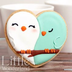 heart cookie cutter is perfect for making 2 love birds on a sugar cookie.