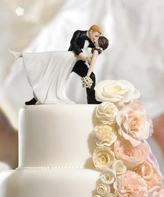 This Couple is wrapped in a romantic embrace of dance. The Bride's pretty pony tail, simple dress and rhinestone shoes give this Cake Topper a lovely modernized twist on a classic pose. Personalize the look by selecting a colored shoe for the Bride. Hand $39.98