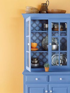 Complementary Colors  A plain cabinet gets a new spark of life when painted this azure hue. A patterned background is a unique touch, especially when it incorporates the wall color -- in this case a muted terra-cotta. Because orange and blue are opposites on the color wheel, they complement each other beautifully