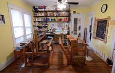 """Allison Volek Shelton   home weaving studio   Nashville, Tennessee   c. 2013   """"The loom on the left is a 4-shaft Leclerc that was passed down for more than 3 generations until I finally happened upon it. The loom on the right is from the '90s and is an 8-shaft Schacht jack loom."""""""