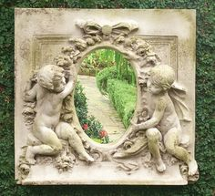 Cherubs With mirror wall Frieze. Great depth with this wall plaque featuring two cherubs with an oval mirror. 12 inches deep and 40 inches wide. Several color combinations possible.
