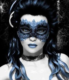 light blue and black masquerade mask