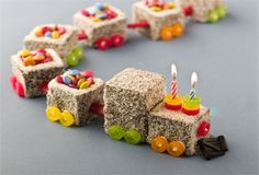 Lamington Train Birthday Cake -- love the candle holders! -- could roll in coloured sugar for colours.