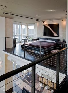 Modern loft space.  Love the railings.  #lofts  #loftdesigns  homechanneltv.com