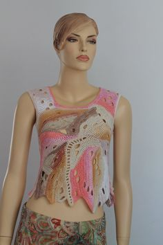This is one of a kind top, performed in the technique FREEFORM.  Its stylish and sexy.  Its perfect for summer.  You can wear with jeans, trousers,