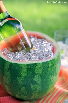 You can forget the typical drink cooler for your next picnic. Keep beverages cold in a fancy-looking watermelon ice bucket you can easily make with a serrated knife and ice cream scoop!