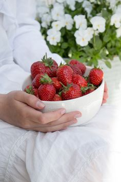 A bowl of sweet red strawberries.  Sommarbacka