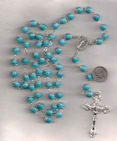 I really could hoard rosary beads.  Just love them.
