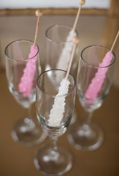 Champagne Glasses with Rock Candy Stirrers | Preppy Pink and Gold Details to Steal for Your Glam Wedding | https://www.theknot.com/content/preppy-kate-spade-wedding-details