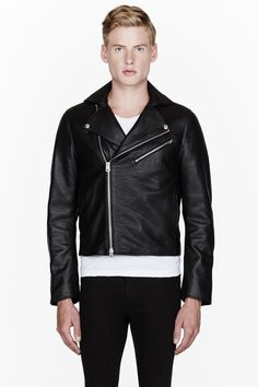 ACNE STUDIOS //  Black full grain leather and suede Gibson jacket  32129M030001  Long sleeve full grain leather jacket in black. Notched lapel collar with press-stud fixtures. Two-way zip closure at front. Seam pockets and welt pockets at front. Tonal suede panels at lower back and forearms. Welt pockets at interior. Fully lined. Zippered sleeve cuffs. Shell: 100% calf leather. Lining: 100% polyester. Specialty cleaners. Imported.  $1450 CAD