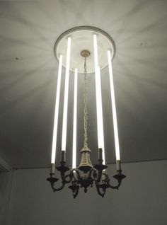I love the juxtaposition of old and new here with the tube lighting in the old light fixture. So clever.
