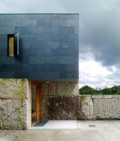 Raw quarried blocks and black slate cladding, Carlos Quintans: