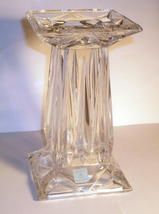 """From the Partylite Crystal Quad Prism collection, this is a tall candle holder or vase. Turned one way, it holds a ball candle or pillar candle. Turned the other way, it can be used a vase. It is 24 percent lead crystal, and has a beautiful faceted design. It stands 7"""" tall and is heavy."""