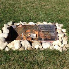 55 gallon drum cut in half.  Perfect backyard fire pit!