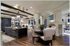 Kitchen! Love everything about this!  Look thru fireplace, vaulted ceiling, hardwoods, stone under molding on mantel.