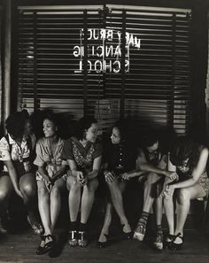 A group of girls sit together at a dancing school in Harlem, 1935