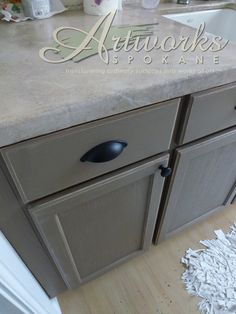 Annie Sloan Coco Chalk Paint™ on laundry room cabinets.