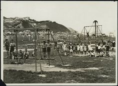 Children in a playground in Kilbirnie, Wellington. A game of cricket is being played in the background. Photographed circa by an unidentified. Old Pictures, Old Photos, Wellington New Zealand, The Hutt, Kiwiana, What Is Like, Abandoned Places, Historical Photos, Playground