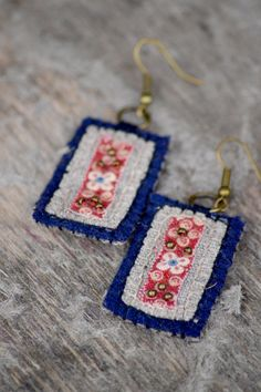 These, eco-friendly, soft and light woolen earrings are made of dark blue woolen, floral cotton and natural linen fabric. Perfect for every season and event - easy and light to wear!      Earrings are hand-embroidered together with merino woolen yarn. Embellished with bronze colored brass beads. Earrings hooks are nickel free.      Materials:  100% wool  100% linen  100% cotton  nickel free brass    size: 3,5 x 2,3 cm (1,37 x 0,90 inches)    Care : hand wash cold water with soft detergent…