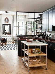 nate berkus' manhattan kitchen with built in window and gorgeous island