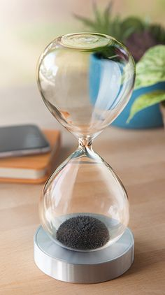 Filled with iron filings instead of sand, the Magnetic Hourglass has a rare earth magnet in its base which inexorably draws the filings toward it. Sand Hourglass, Used Video Games, Desk Toys, Science Gifts, Rare Earth Magnets, How To Plan, Design, Money, Nice