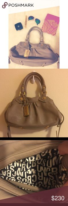 """Marc by Marc Jacobs Classic Q Baby Groove Authentic Marc by Marc Jacobs Classic Q Baby Groove   ⁃Cement Gray with gold hardware ⁃Excellent used condition  ⁃Super clean interior and exterior, smoke free home ⁃Study U Shape handles makes it easy to carry ⁃Adjustable and removable shoulder straps ⁃4 anchored knob-feet on the bottom in gold.  ⁃100% cow leather ⁃13.25"""" X 6.75"""" x 7.5"""" ⁃7"""" Handle Drop, 15"""" Shoulder drop   *** NO TRADES*** Marc by Marc Jacobs Bags Satchels"""