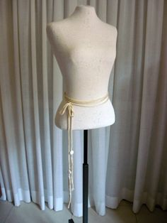 Very long, cotton, knit belt with beaded extra long tassels, beige