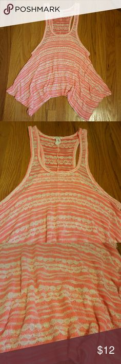 "Bethany Mota Neon Coral Layering Tank Top XS Cute layering knit tank top by Bethany Mota.  Size junior's XS.  Low armholes, racerback, flowy top with hankerchief hem.  White and neon pink-coral knit fabric.  Measures 30"" around under the armholes.  Length is 23"" to 29"" from the shoulder and is slightly cropped.  Rayon/ polyester/ spandex knit.  This is neon, hard to capture in photos.  This is in excellent unworn condition, without tags. Bethany Mota Tops Tank Tops"