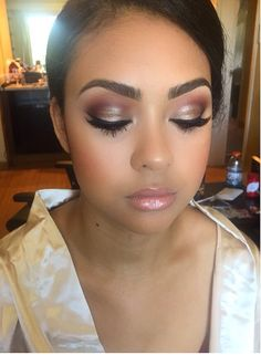 Beautiful makeup Bridal makeup look. Stop by Top Level Salon for this look. Follow us on IG and FB @TopLevelSalon