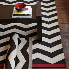 Perfect Run to Match my couch.  I love the Zigzag Rug - Iron on westelm.com