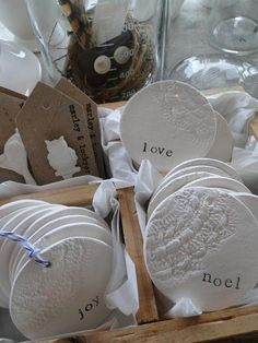 clay tag stamped with doily and letters-Maybe part of our centerpieces or our favor?