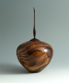 Walnut hollow form with Indian rosewood finial, by Scott Hackler.